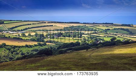 hills and pastures in Exmoor. On the horizon is seen sea. North Devon. UK