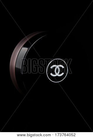 LONDON UK - FEBRUARY 28 2017 Chanel face cream container with black logo. On black background with reflection