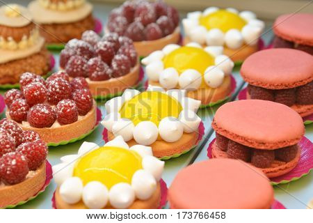 Raspberry macaroons and tarte of lemon. Pie.