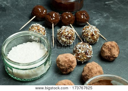 Various Protein Energy Balls And Dessicated Coconut In Bowl