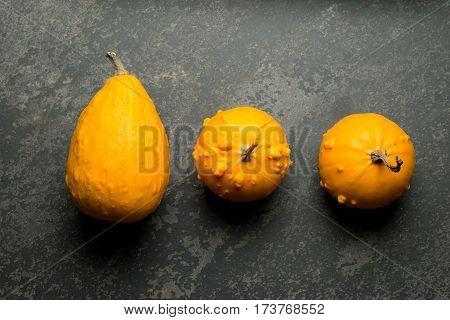 Overhead Of Three Yellow Bumpy Squash