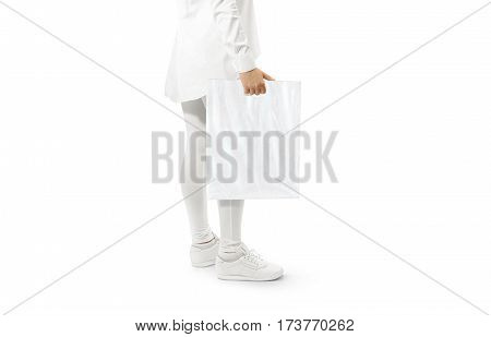 Blank white plastic bag mockup holding hand. Woman hold clear carrier sac mock up. Plain bagful branding template. Shopping carry package in persons arm. Promotional packet for logotype branding.