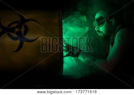 "Photo of a bearded male with smoking ""biohazard"" barrel, strong dystopian/post apocalyptic vibes."
