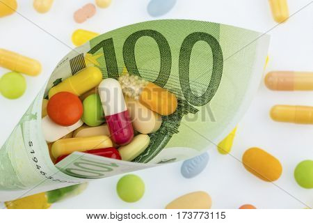 tablets and one hundred euro note