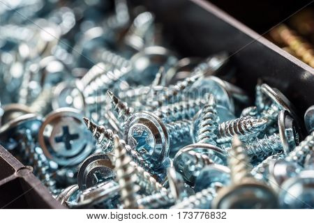 Screws in plastic box closeup macro background