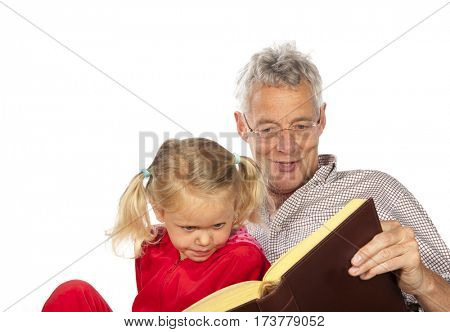 Grand-father is reading to his grand-child isolated over white background