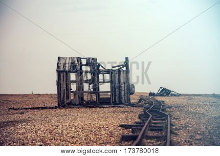 Old wooden shacks on Dungeness beach, Kent, UK