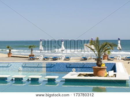 SAINT CONSTANTINE AND HELENA BULGARIA - APRIL 10 2015: Beach and swimming pool of Azalia hotel. Saint Constantine and Helena is the oldest first sea resort of Bulgaria exists from 19 century.