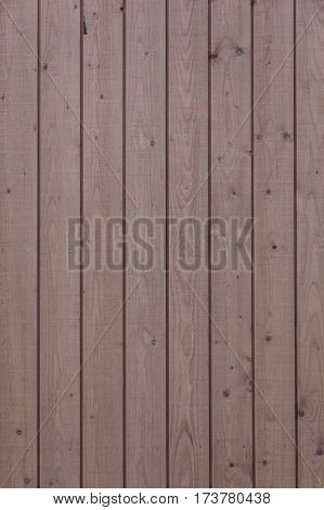 horizontal part of vertical planks with light brown varnish