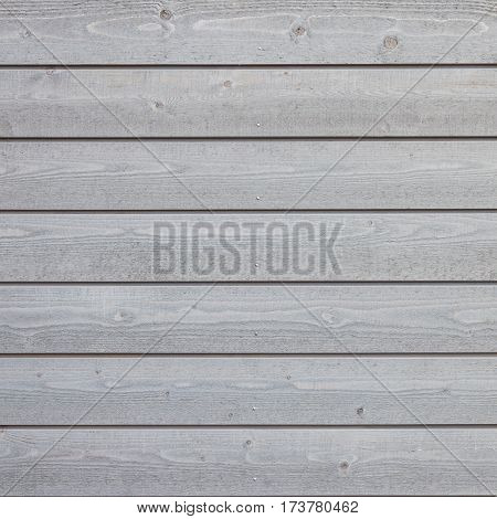 square part of horizontal planks with light grey varnish