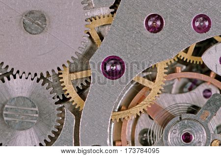 Close-up of mechanism of old watch. Photo macro.