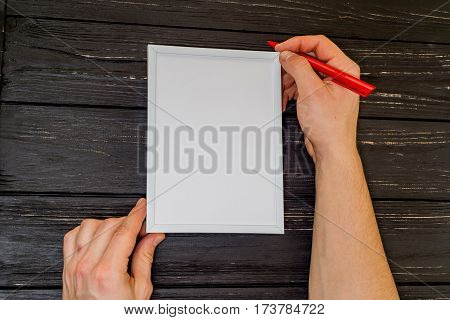 Male Hand Written On Frame