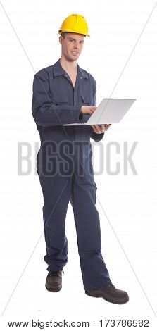 Young worker with yellow helmet and laptop isolated on white background