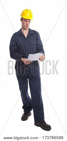 Young worker with yellow helmet and paper isolated on white background