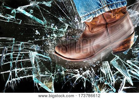 Western cowboy boots kicking and stomping shattered glass.
