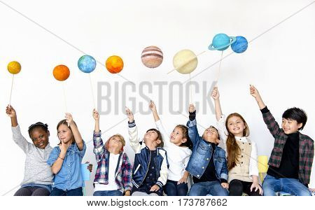 Group of Kids Holding Papercraft Galaxy Symbol on White Blackground