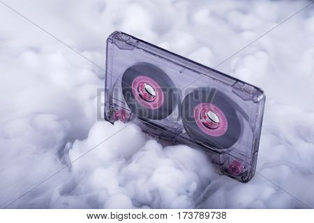 Cassette tape in clouds. Sound cloud. Conceptual image. Selective focus