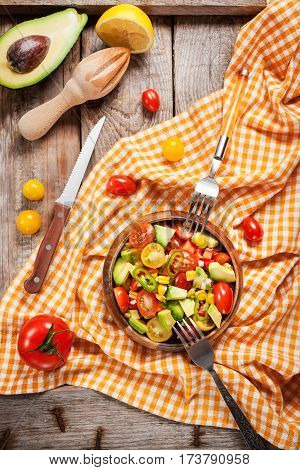Salad With Avocado, Sweet Corn, Tomatoes, Onion And Jalapeno Pepper
