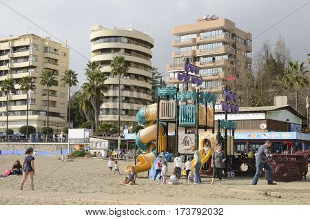 MARBELLA, SPAIN - FEBRUARY 26, 2017: Kids playing at the beach in Marbella Andalusia Spain.