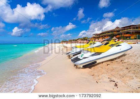 PLAYA DEL CARMEN, MEXICO - JULY 11, 2011: Jet ski for rent on the beach of Playacar at Caribbean Sea of Mexico. This resort area is popular destination with the most beautiful beaches.