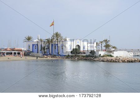 MARBELLA, SPAIN - FEBRUARY 26, 2017: Blue and white building at the marina of Marbella Andalusia Spain.