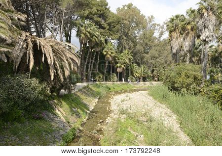 MARBELLA, SPAIN - FEBRUARY 26, 2017: Path to a stream in the city of Marbella Andalusia Spain.