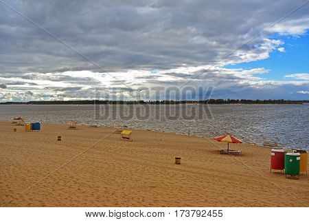 Samara, city beach on the shores of the Volga River in anticipation of thunderstorm, beautiful cumulus clouds before rain