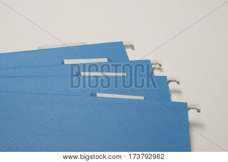 Blue file folder for organizing documents for business and personal use.