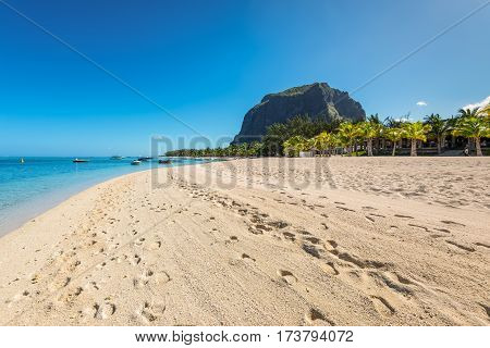 Le Morne Mauritius - December 11 2015: A wide-angle view on the Le Morne Beach one of the finest beaches in Mauritius. Le Morne Brabant mountain in the background.