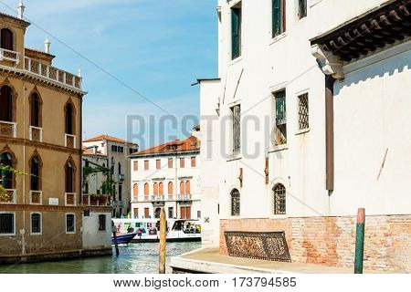 VENICE, ITALY - June 30, 2016.street view of old buildings in Venice on June 30, 2016. its entirety is listed as a World Heritage Site, along with its lagoon.June 30 VENICE, ITALY