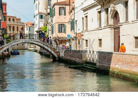 VENICE, ITALY - June 30, 2016.View of water street and old buildings in Venice on June 30, 2016. its entirety is listed as a World Heritage Site, along with its lagoon.June 30 VENICE, ITALY