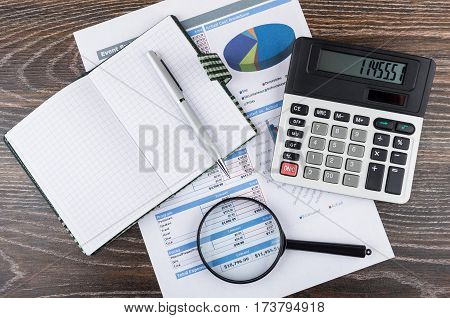 Printout With Chart, Calculator, Magnifying Glass, Notepad And Pen