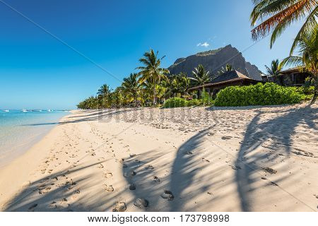 Le Morne Mauritius - December 11 2015: Amazing white beaches of Mauritius island. Tropical vacation in Le Morne Beach Mauritius. Le Morne Brabant mountain in the background.