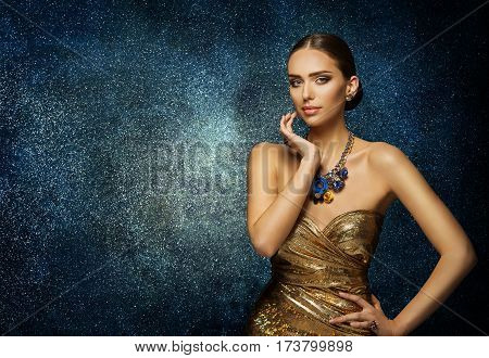 Fashion Model Face Portrait Elegant Woman in Necklace Jewelry Young Slim Lady Posing over blue background