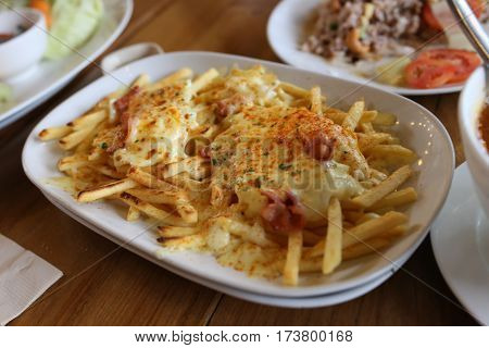 French fried with melting cheese look so yummy