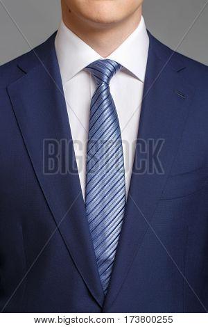 Man In Blue Tuxedo With Light Blue Tie