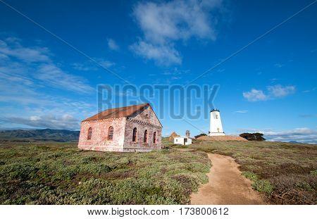 Piedras Blancas lighthouse and redbrick fog signal building on the Central California Coast north of San Simeon California USA