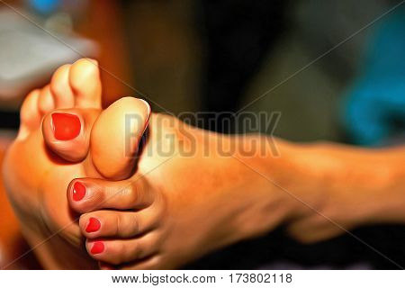 Toes clutching a big toe with red nail polish