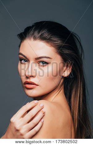 Portrait Of Beauty Girl With Beauty Skin, Touch Body With Hands On Grey Background. Cosmetics Or Spa