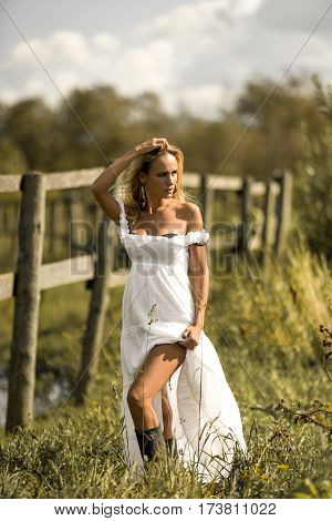 Beautiful Woman In White Dress Walking Around The Farm