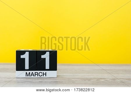 March 11th. Image of march 11 wooden color calendar on white background. Spring day, empty space for text.