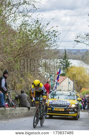 Conflans-Sainte-HonorineFrance-March 62016: The New Zealand cyclist George Bennett of Lotto NL-Jumbo Team riding during the prologue stage of Paris-Nice 2016.