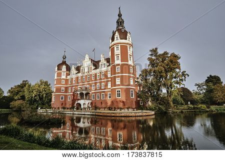 moat and New Castle in the park Muskauer in Germany
