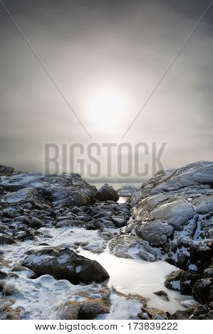 High contrast foggy winter landscape by the shore