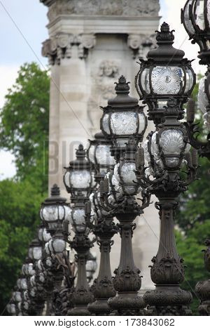 Street lamps in Alexandre III Bridge in Paris, France