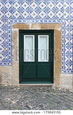 A typical portuguese door with azulejo tiles