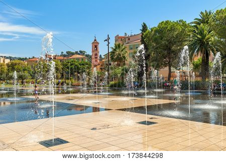 NICE, FRANCE - SEPTEMBER 02, 2015: People among fountains at Promenade du Paillon - 12 hectares, 1.2km long new green pedestrian walkway area in the heart of Nice opened on October 26, 2013.