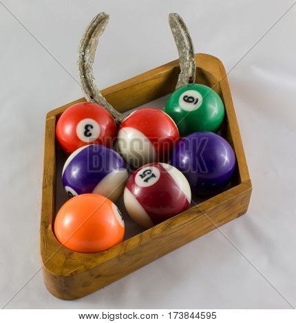 Nine Ball Pool Rack With Horseshoe in rack in place of some balls