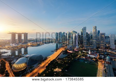 Aerial view of Singapore business district and city at twilight in Singapore Asia.