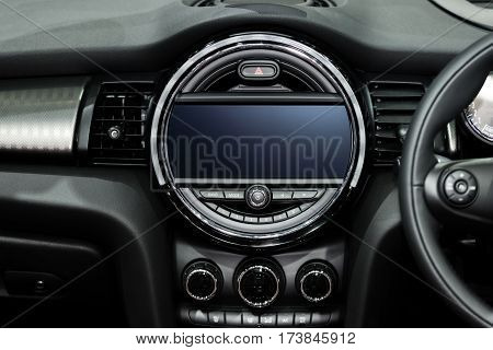Interior view of car. Modern technology car dashboard radio and aircondition control button.